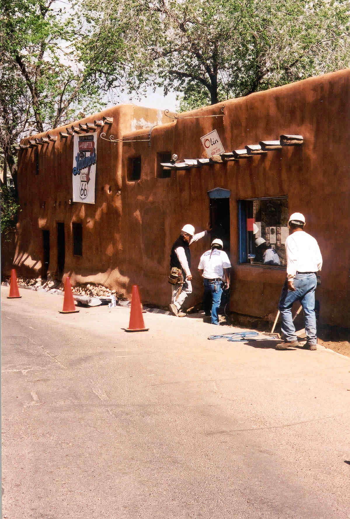 On May 15, 2003, Hampton Hotel volunteers converged at the Oldest House under the guidance of Cornerstones, a local non-profit organization dedicated to restoring rural Hispanic villages and Indian Pueblos, to rehabilitate this historic structure. The refurbishment involved recreating its original mud bricks and plaster substance to re-plaster the interior walls; re-roof the structure; repair its entry door; remove street concrete pavement that was retaining moisture and damaging its walls; creating a bed o