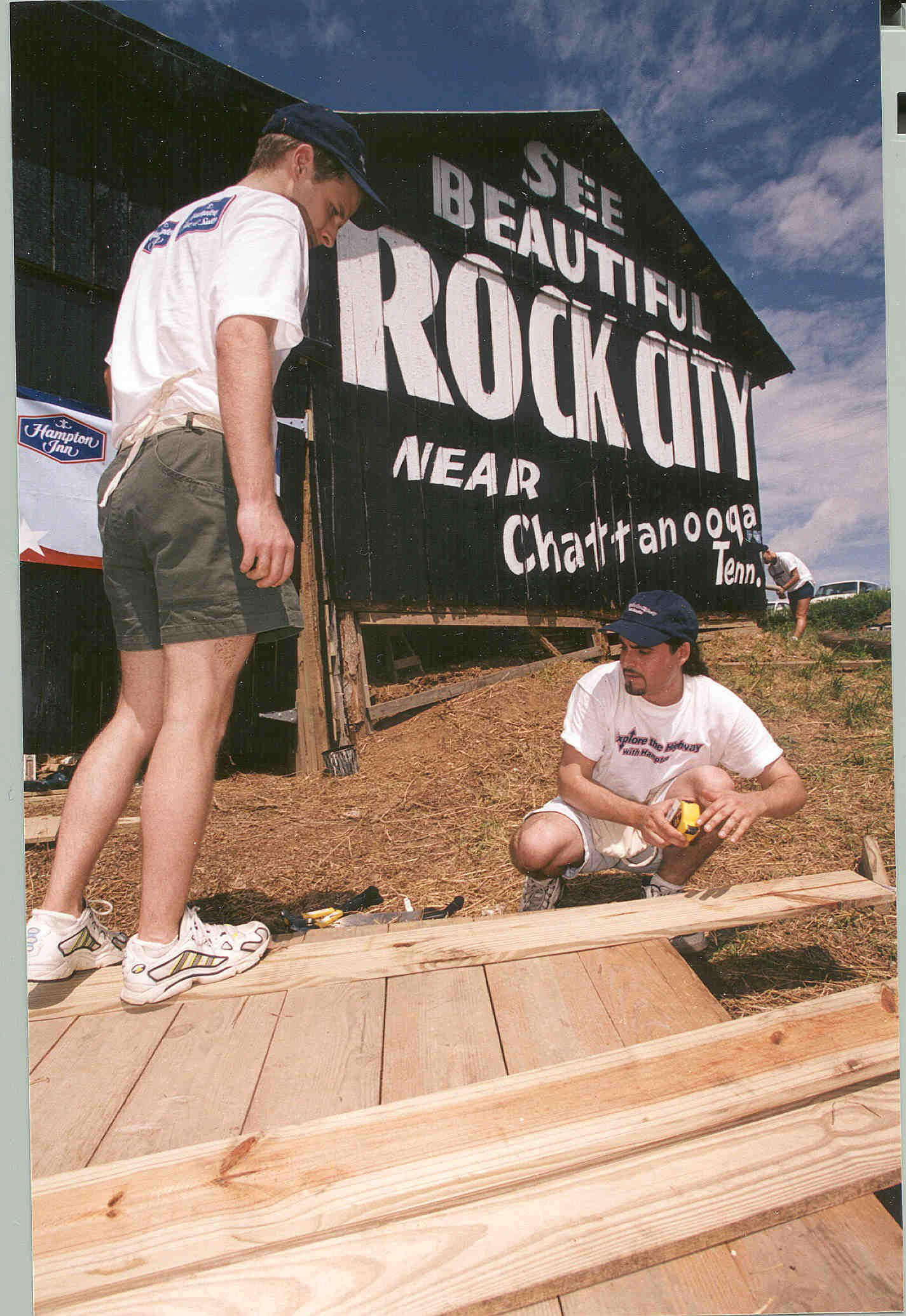 "Hampton employees and community volunteers partnered together to repaint and restore the ""See Rock City"" barn on June 15, 2000, rebuilding the walls, doors, and roof. Traveling from Nashville, First Lady Martha Sundquist was on-hand assisting the efforts to restore the 60-year old icon."