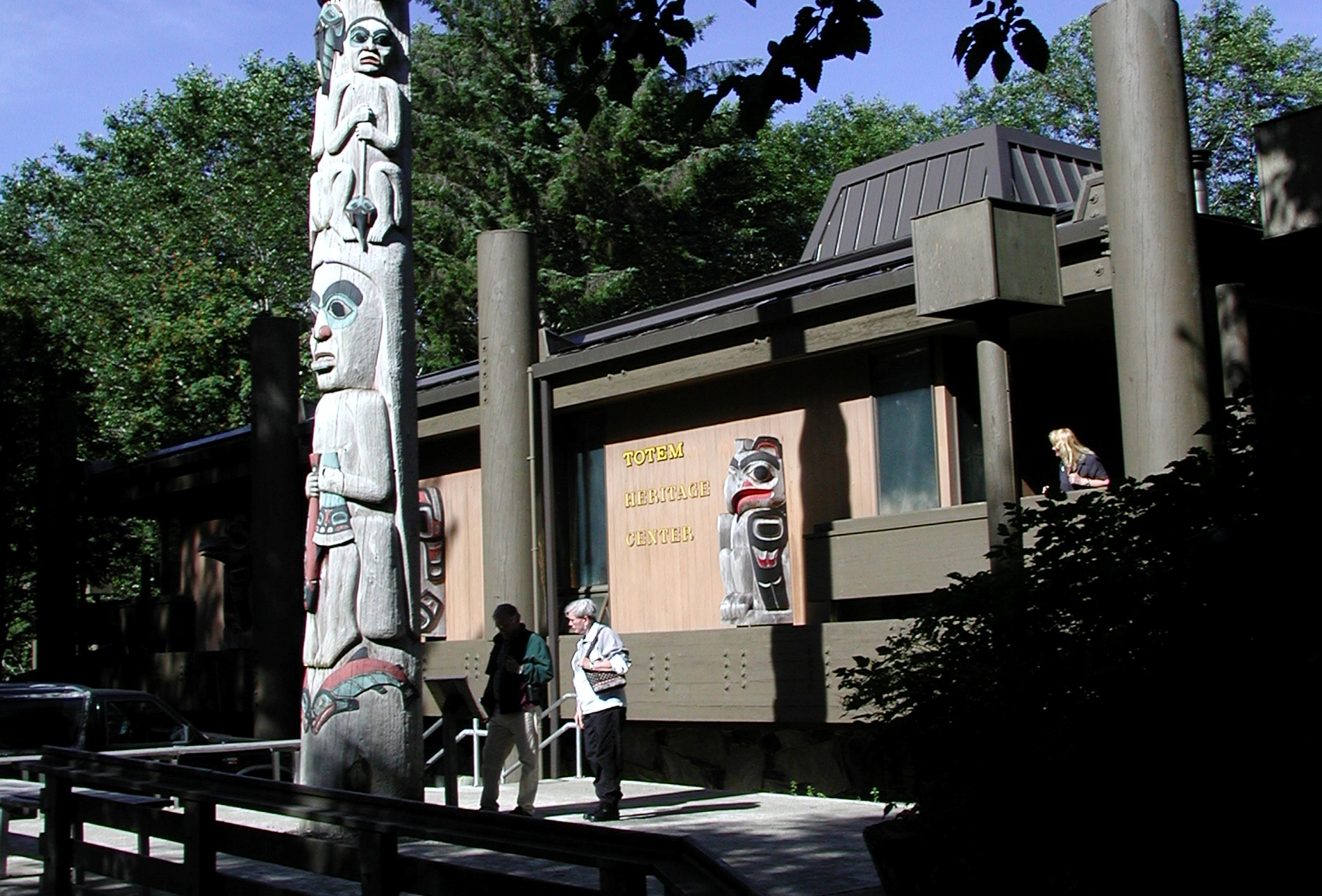 A Fog Woman totem pole in front of Ketchikan's Totem Heritage Center