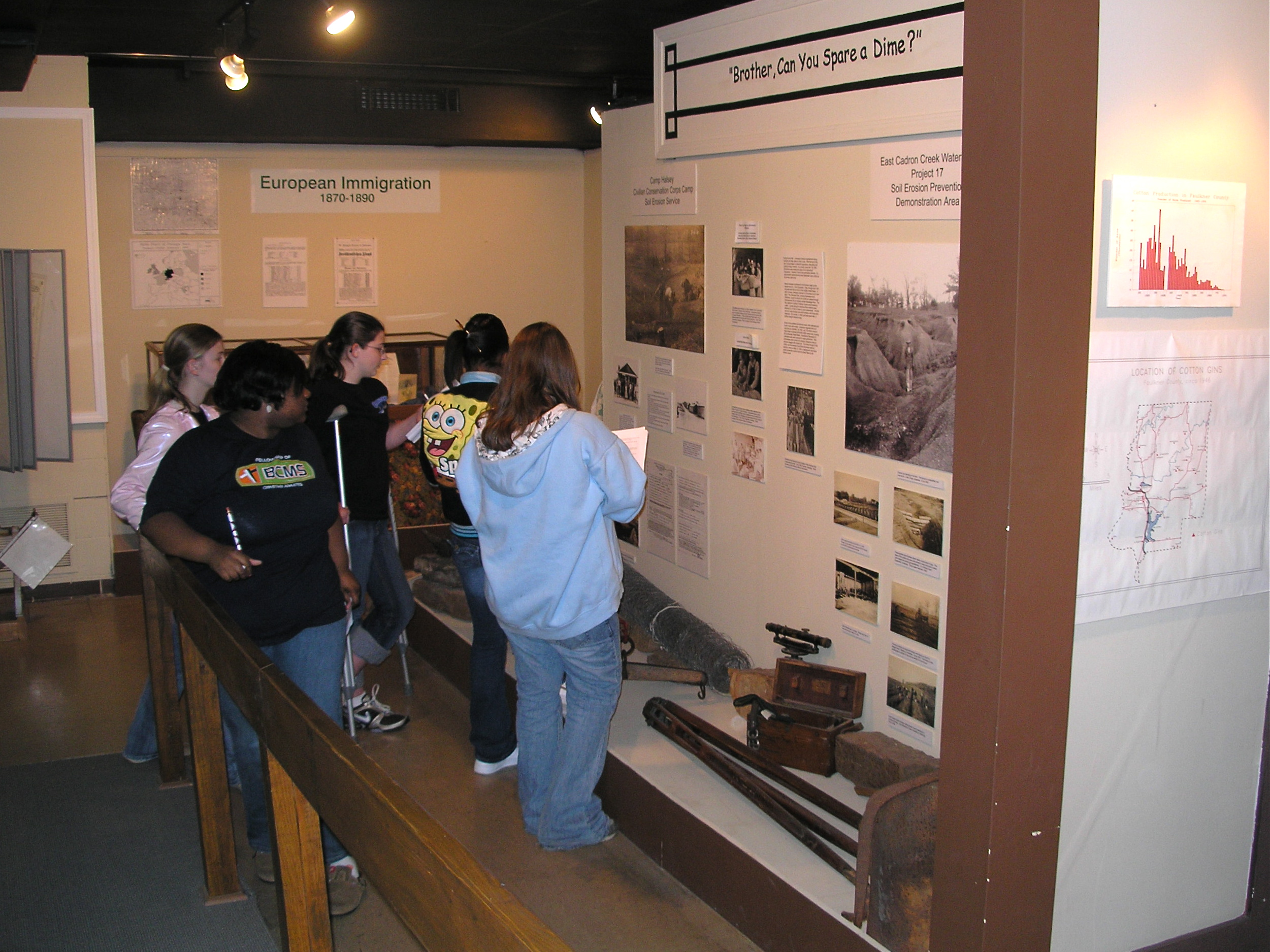 A school group visits the Faulkner County Museum in Conway, Arkansas