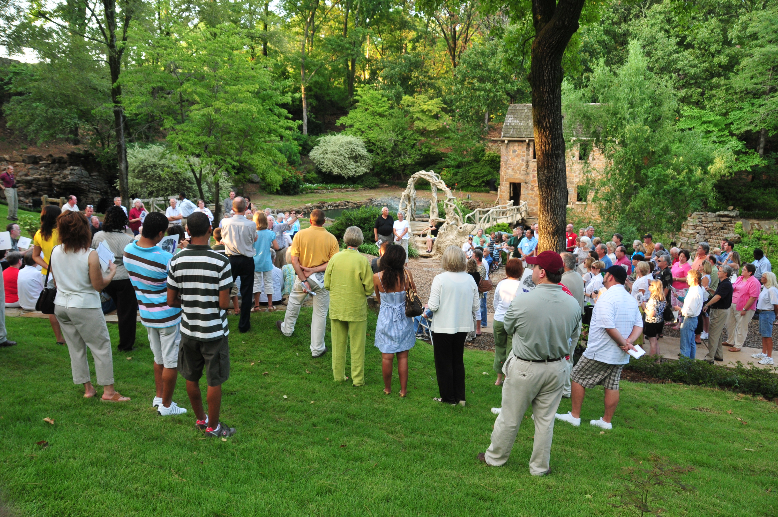 Guests celebrate the rededication of the Old Mill in T.R. Pugh Memorial Park in North Little Rock