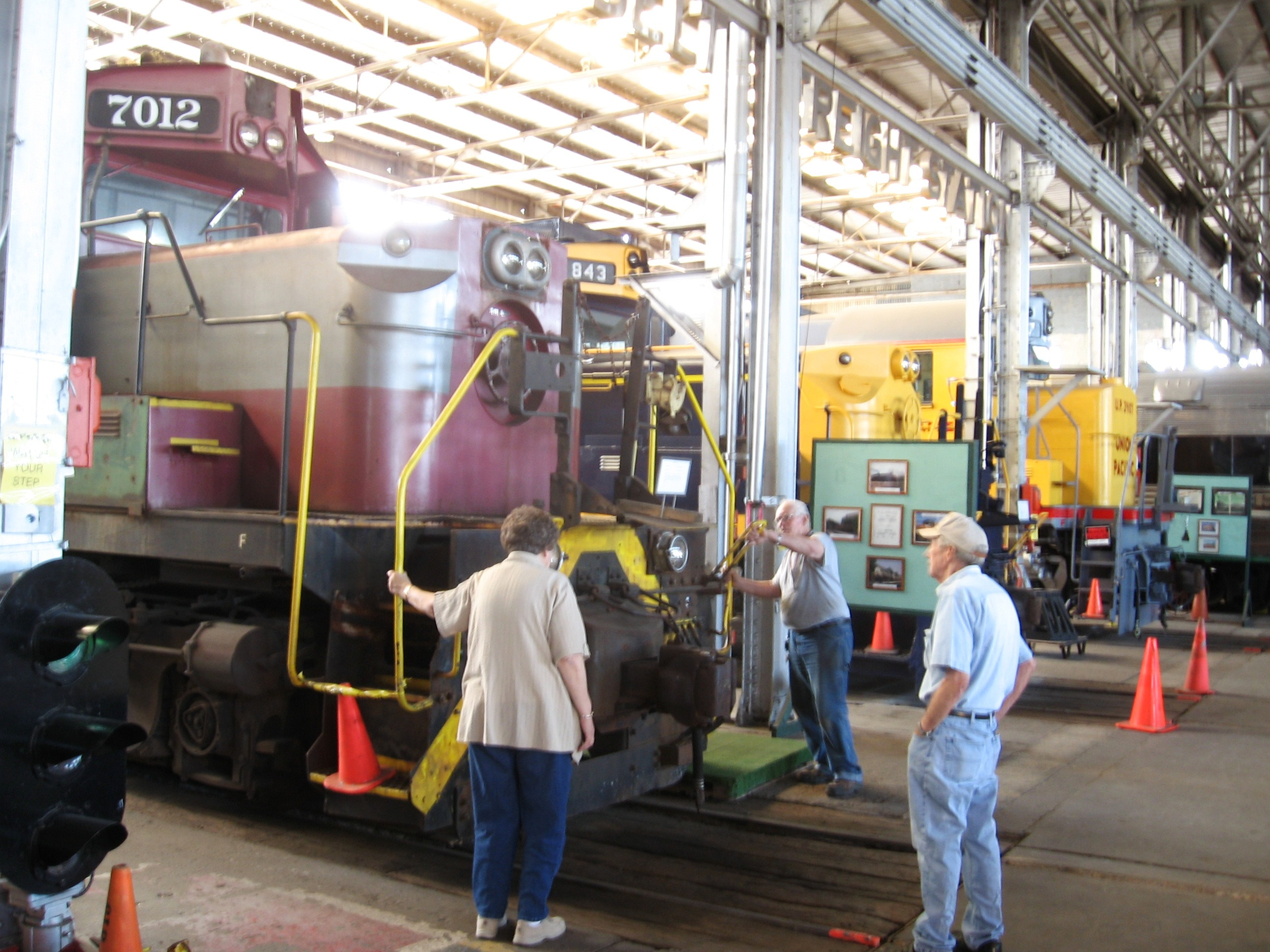 Docent and visitors examining an engine on display at the Rail Road Museum in Pine Bluff, Arkansas