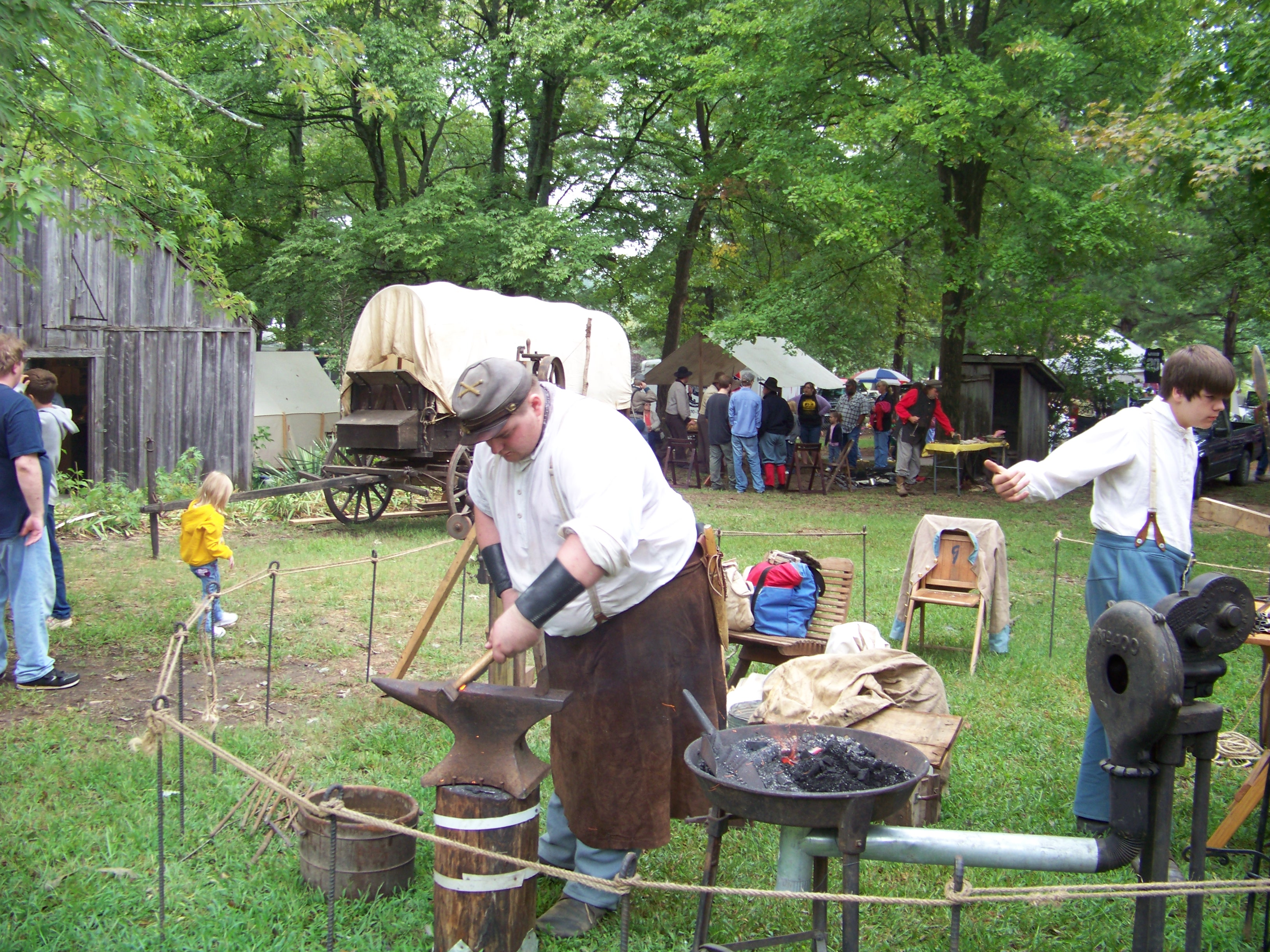 Visitors enjoy a demonstration of blacksmithing skills during  Randolph County Pioneer Days.