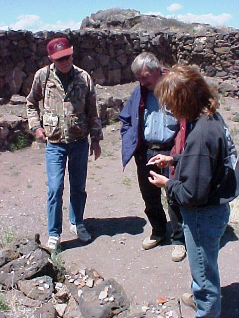 In the Great Kiva at the Casa Malpais site, a guide uses pottery sherds to explain the development of technology and trade