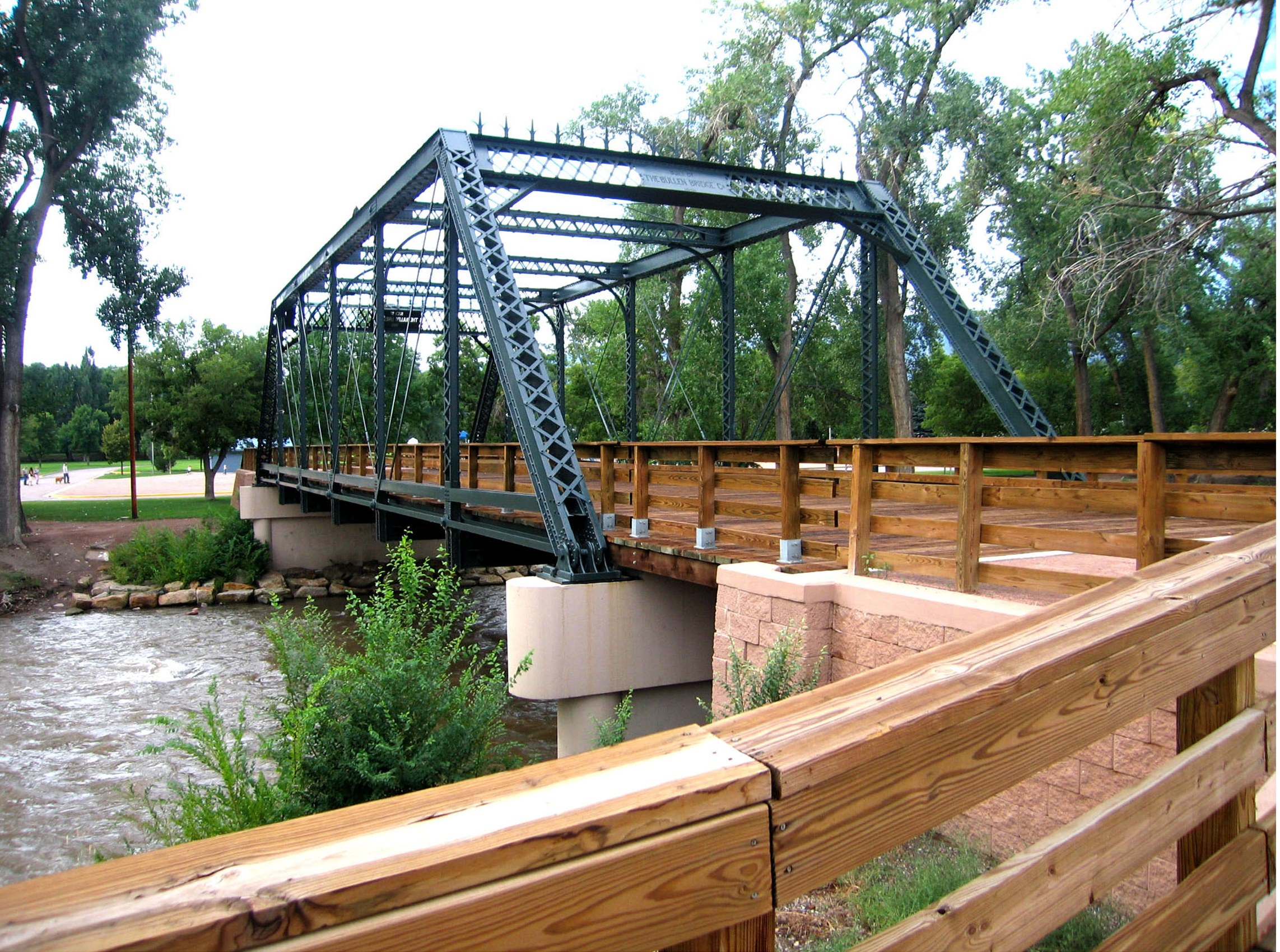The historic Fourth Street Bridge was preserved and utilized as a walkway connecting the historic downtown with Centennial Park.
