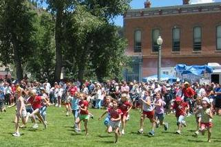 Children enjoy races in a historic downtown park as part of July 4th celebrations in Lake City, Colorado