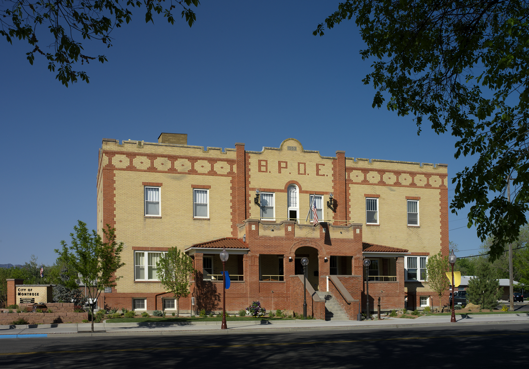 The Elks Lodge in Montrose, Colorado, an award winning adaptive reuse project, now serves as a municipal services center and meeting venue. The restoration included the installation of a renewable energy geo-exchange system for heating and cooling.