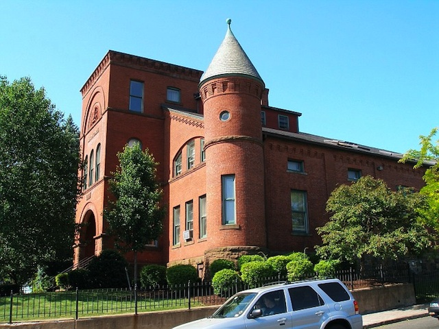 The New Britain Armory, erected in 1886-87, was renovated, after decades of abandonment, into senior citizen housing, adhering to historic preservation standards.