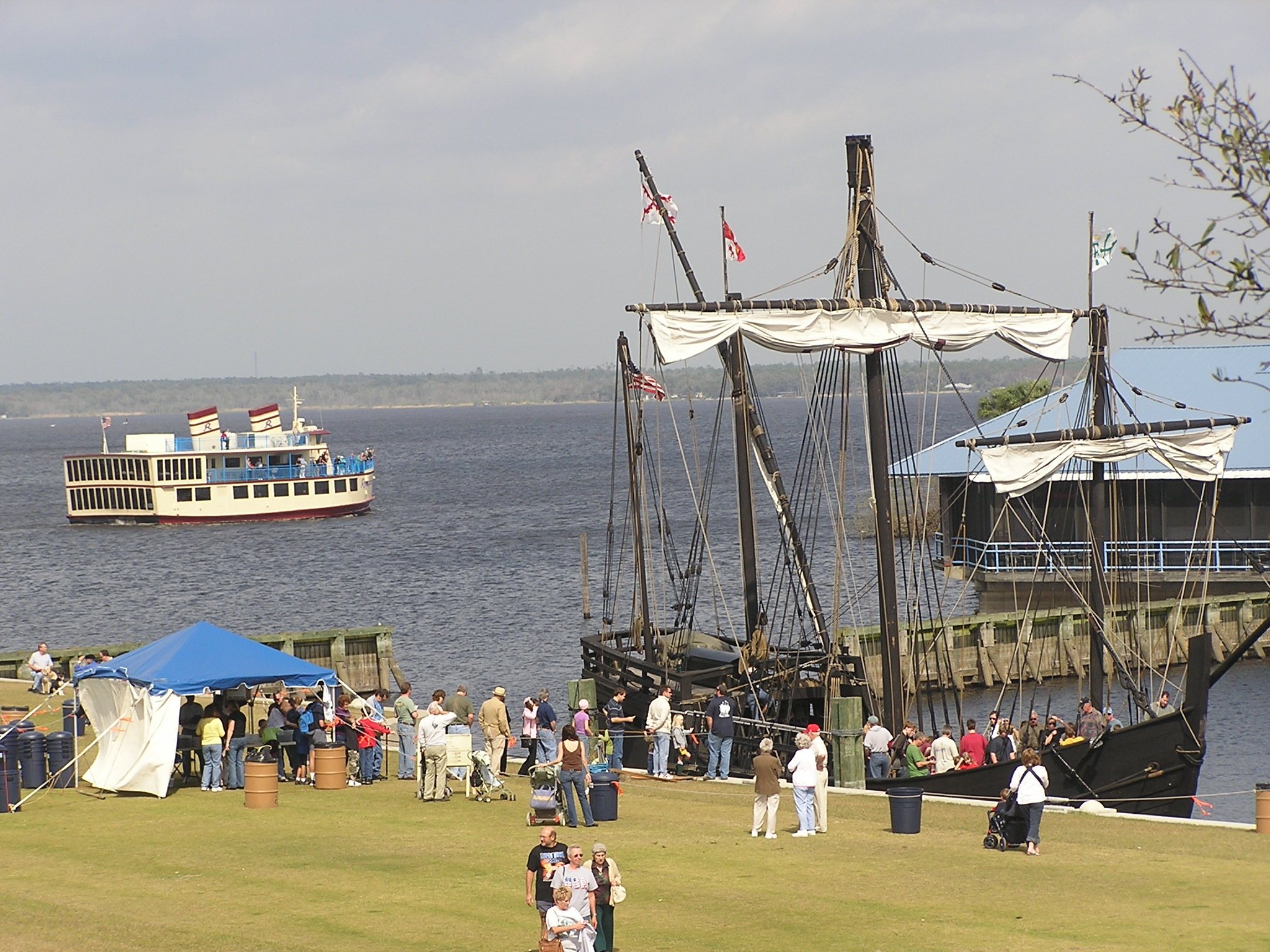"Residents of Sanford, Florida, greeting the arriving ""Nina"", a reproduction of one of Columbus' ships."