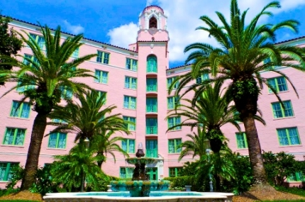The historic Vinoy Hotel in downtown St. Petersburg is a pink Mediterranean revival-style building that overlooks the waterfront on Tampa Bay. It is one of many buildings in St. Petersburg listed on the National Register of Historic Places.