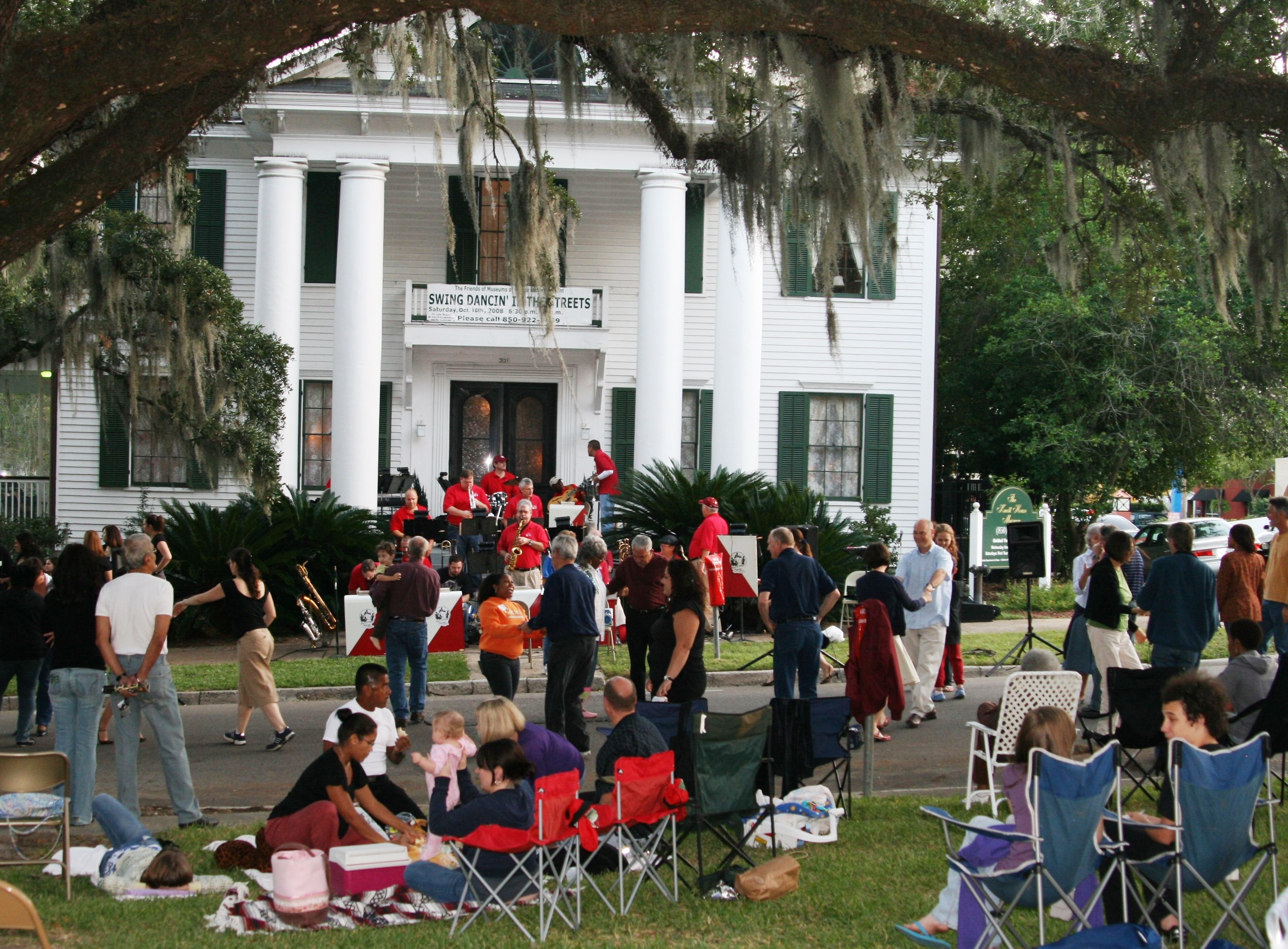 Tallahassee residents swing dancing at the Knott House (1842) Museum