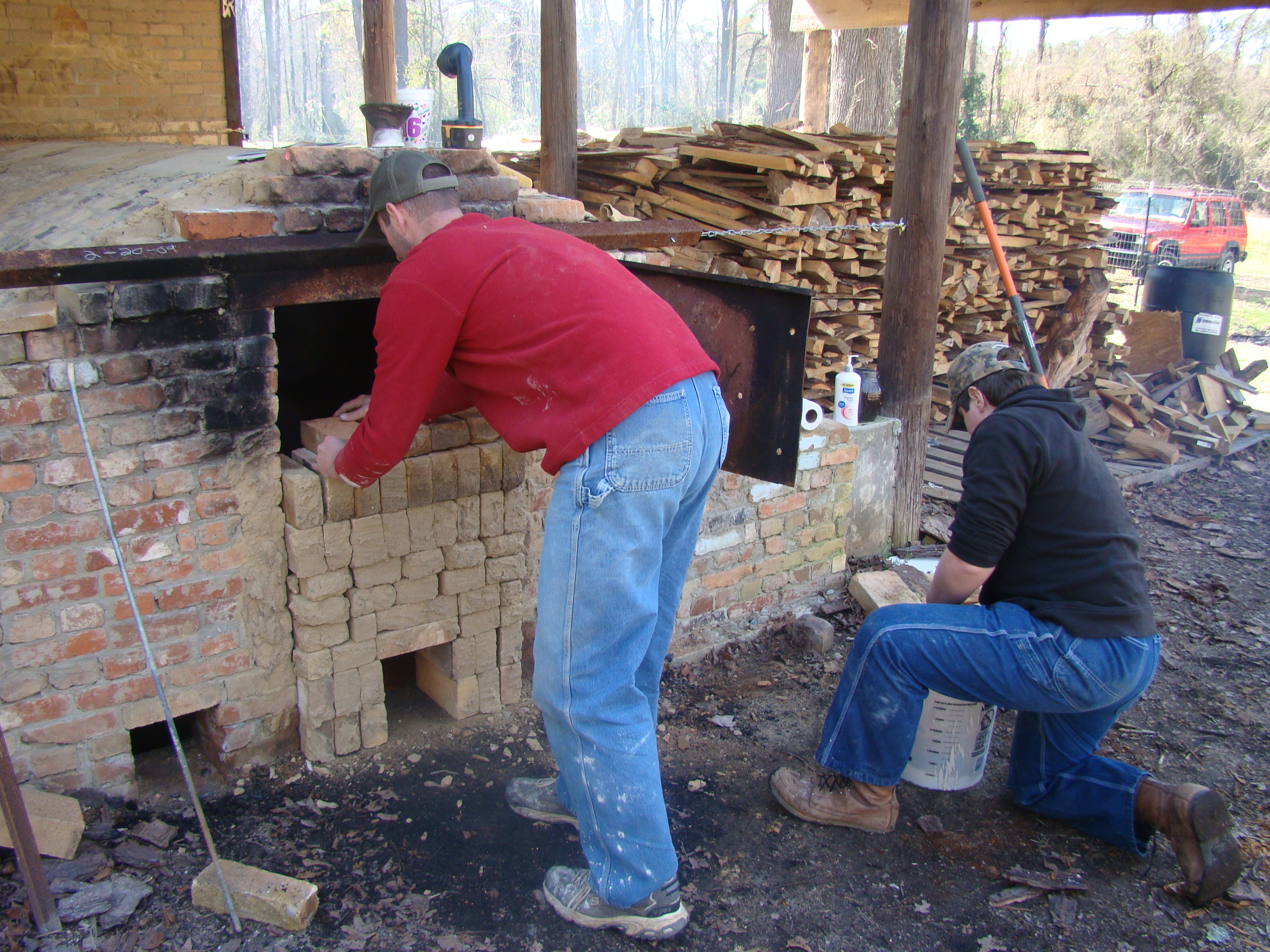 Workers at the Knoxville Bottom Kiln, a reproduction wood-fired brick kiln, demonstrate Crawford County's rich pottery-making traditions.