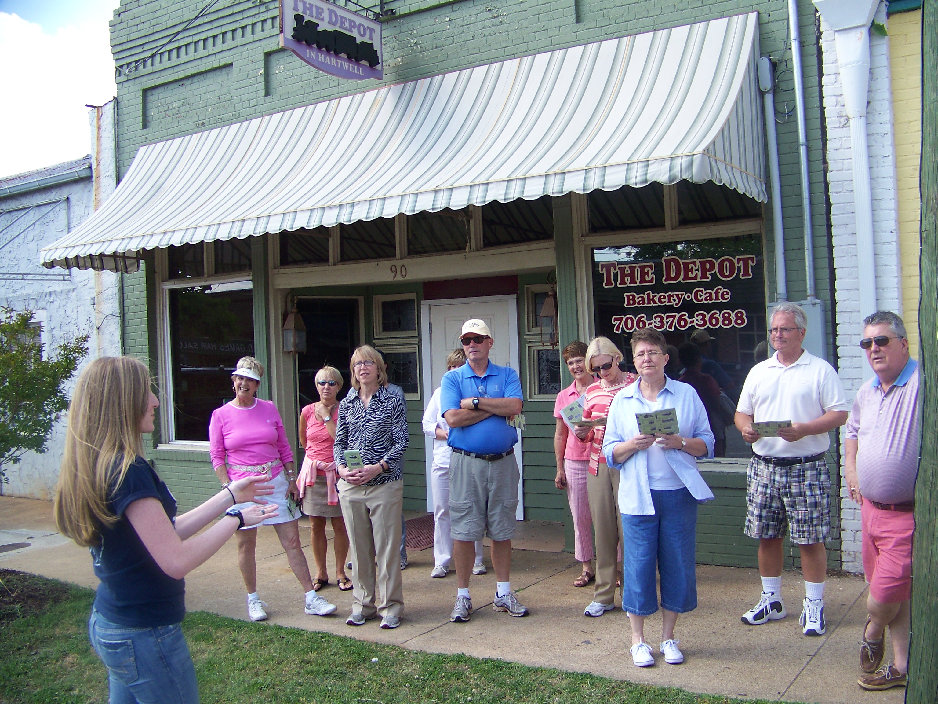 A group on a downtown walking tour in Hartwell, Georgia