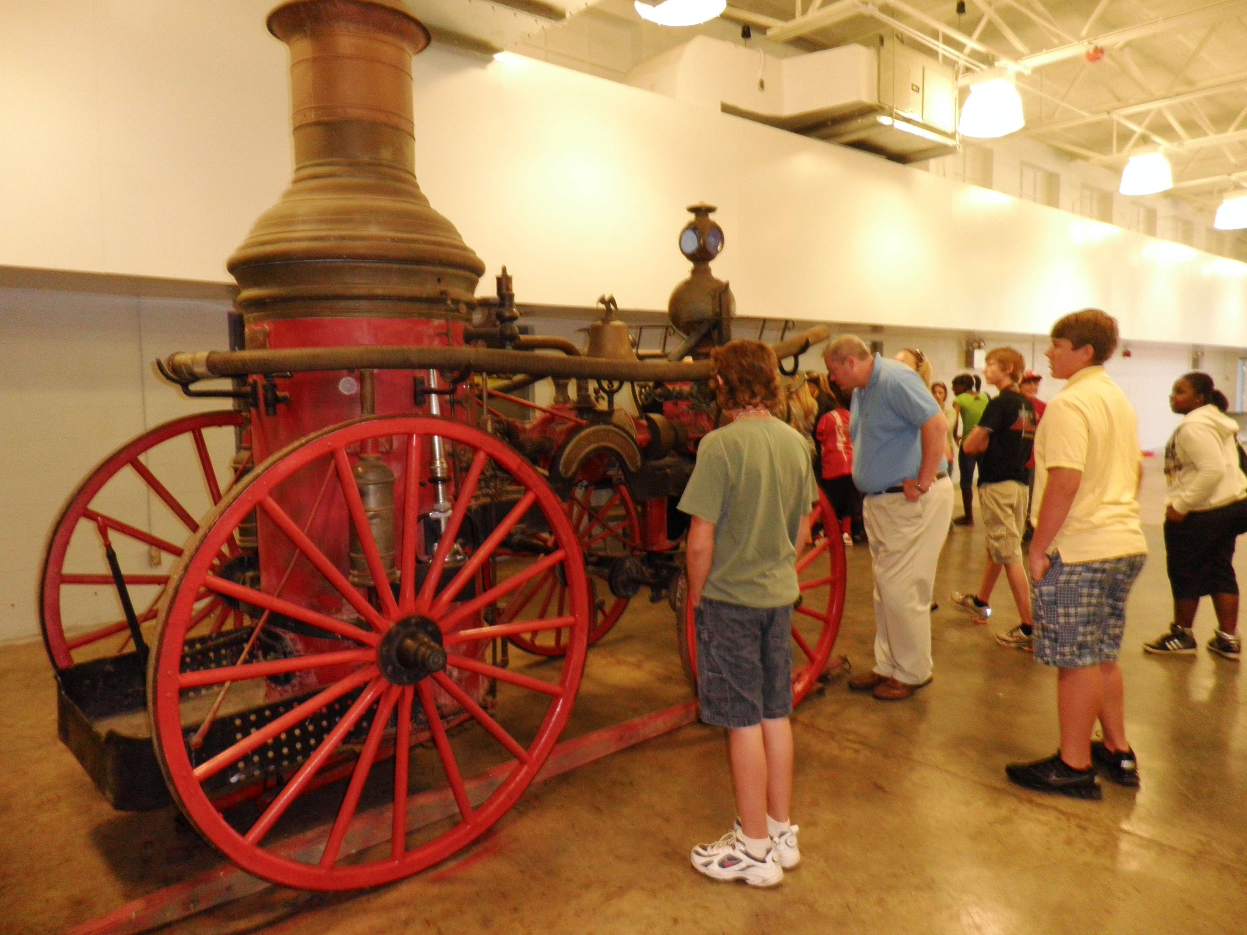 Visitors examine an antique fire engine in Hawkinsville, Georgia