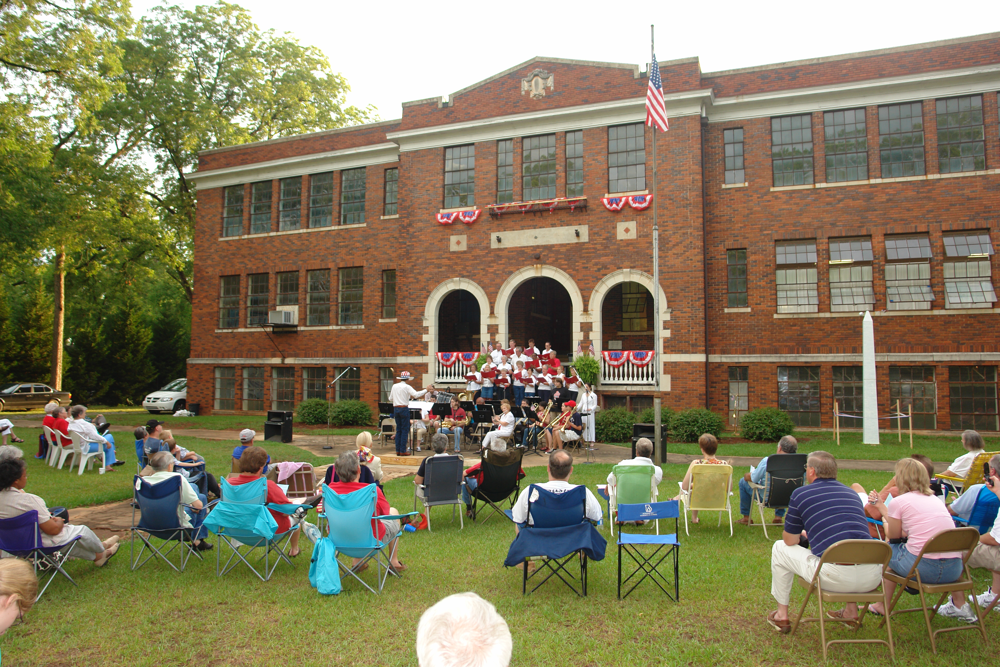 A Fourth of July celebration in front of the restored High School in Monticello, Georgia.