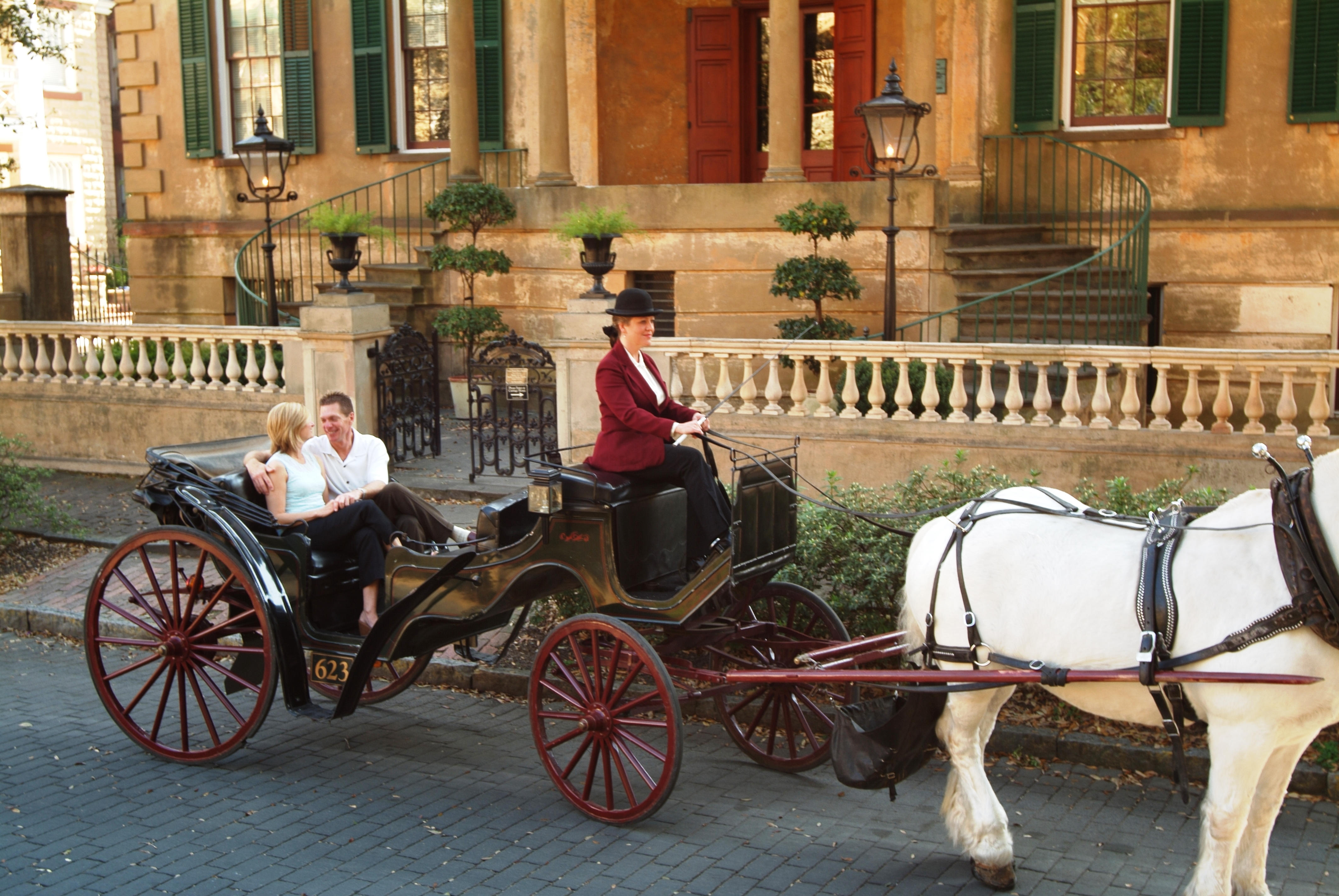 Savannah established the country's largest urban National Historic Landmark District in 1955. Here visitors enjoy a carriage ride around historic Savannah.