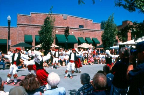 Dancers in traditional Basque costumes perform outside of the Basque Block. The importance of Boise's Basque heritage is highlighted in the revitalization of the historic properties on The Basque Block, a portion of Grove Street.