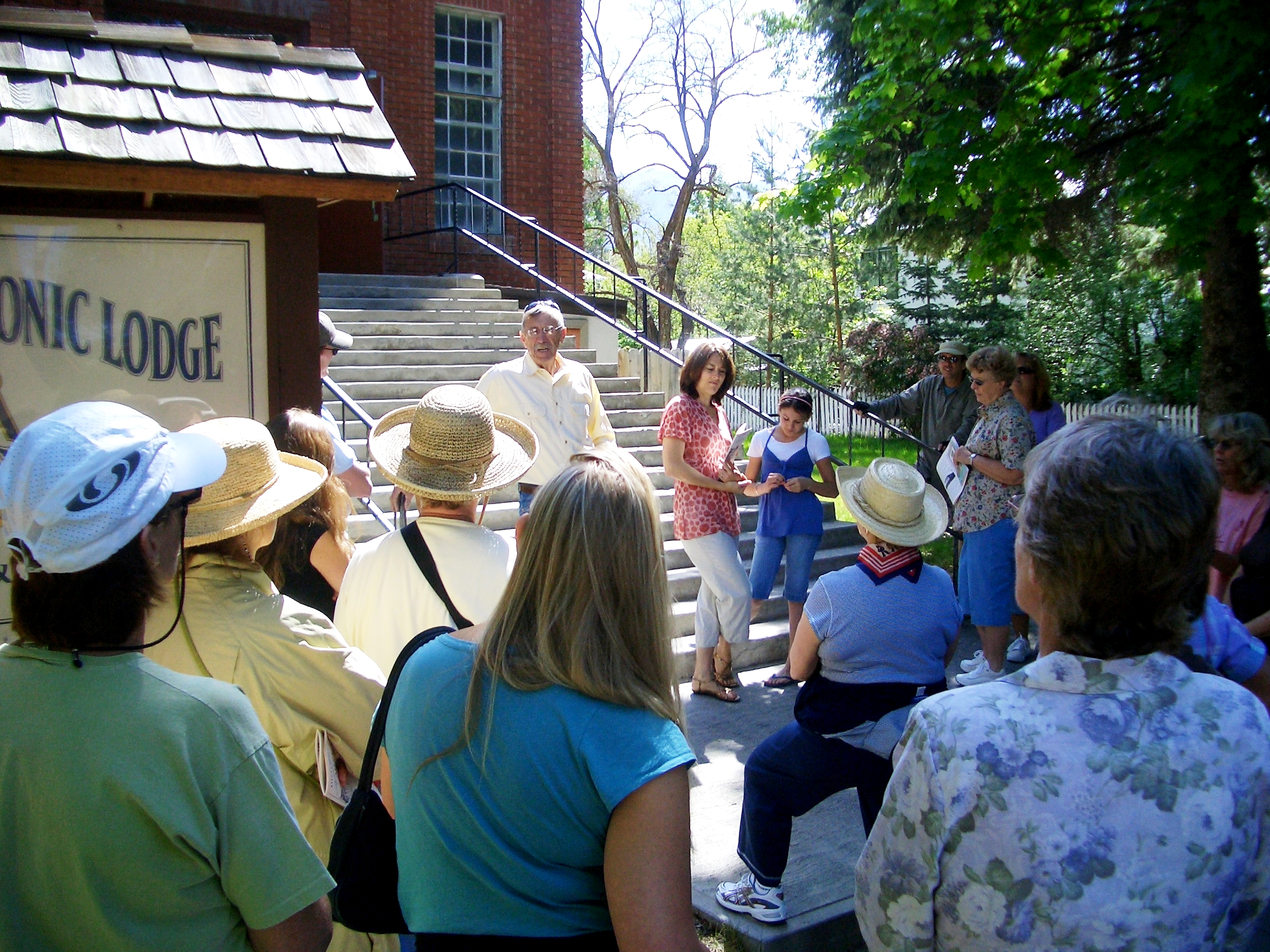 A walking tour group learns about the Masonic Lodge building in Hailey, Idaho