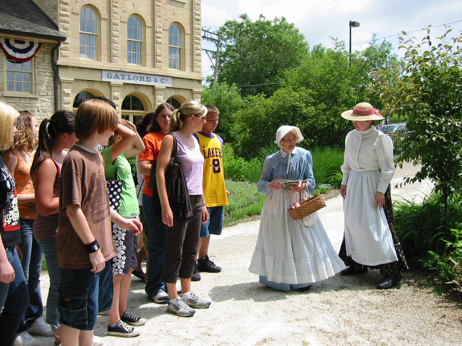 Costumed interpreters lead a school tour at the Gaylord Building in Lockport, Illinois. This 1838 canal warehouse is one of the oldest buildings in northeastern Illinois.