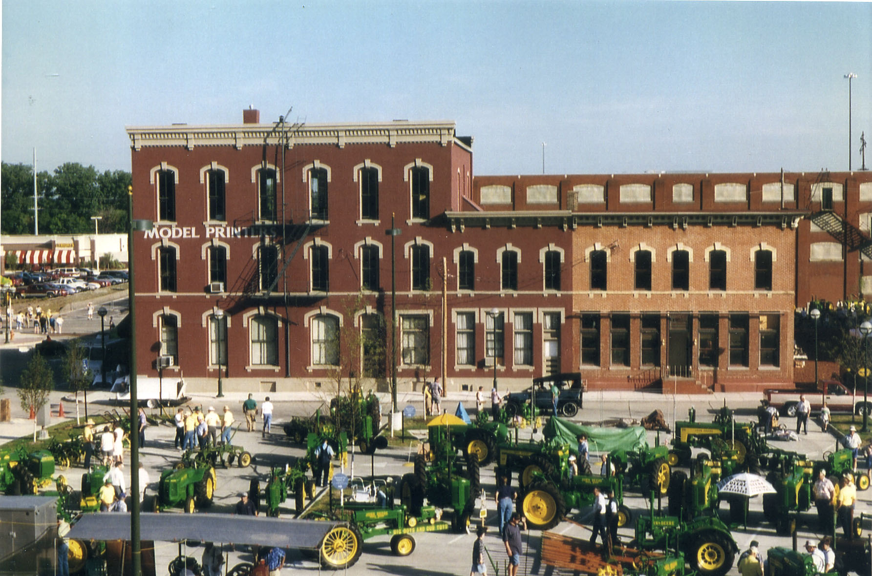 A display of John Deere tractors and other farm equipment Moline, Illinois. A blacksmith named John Deere moved his plow factory to Moline in 1848, and the company maintains a strong presence in the area.