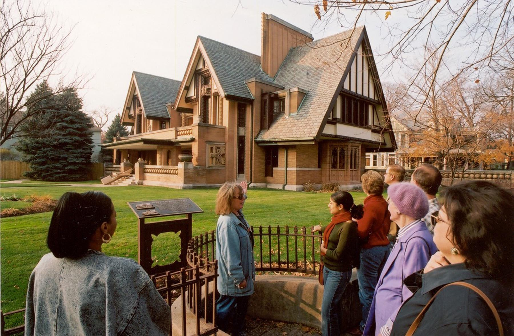 A guide talks with visitors outside the Nathan G. Moore House, also known as the Moore-Dugal Residence, designed by Frank Lloyd Wright. The house was built one block south of Wright's home and studio  in the Chicago suburb of Oak Park, Illinois.
