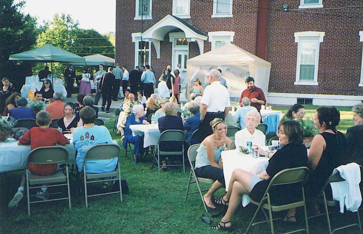 A wedding reception on the grounds of historic Pine Hall (1867) in Bedford, Indiana