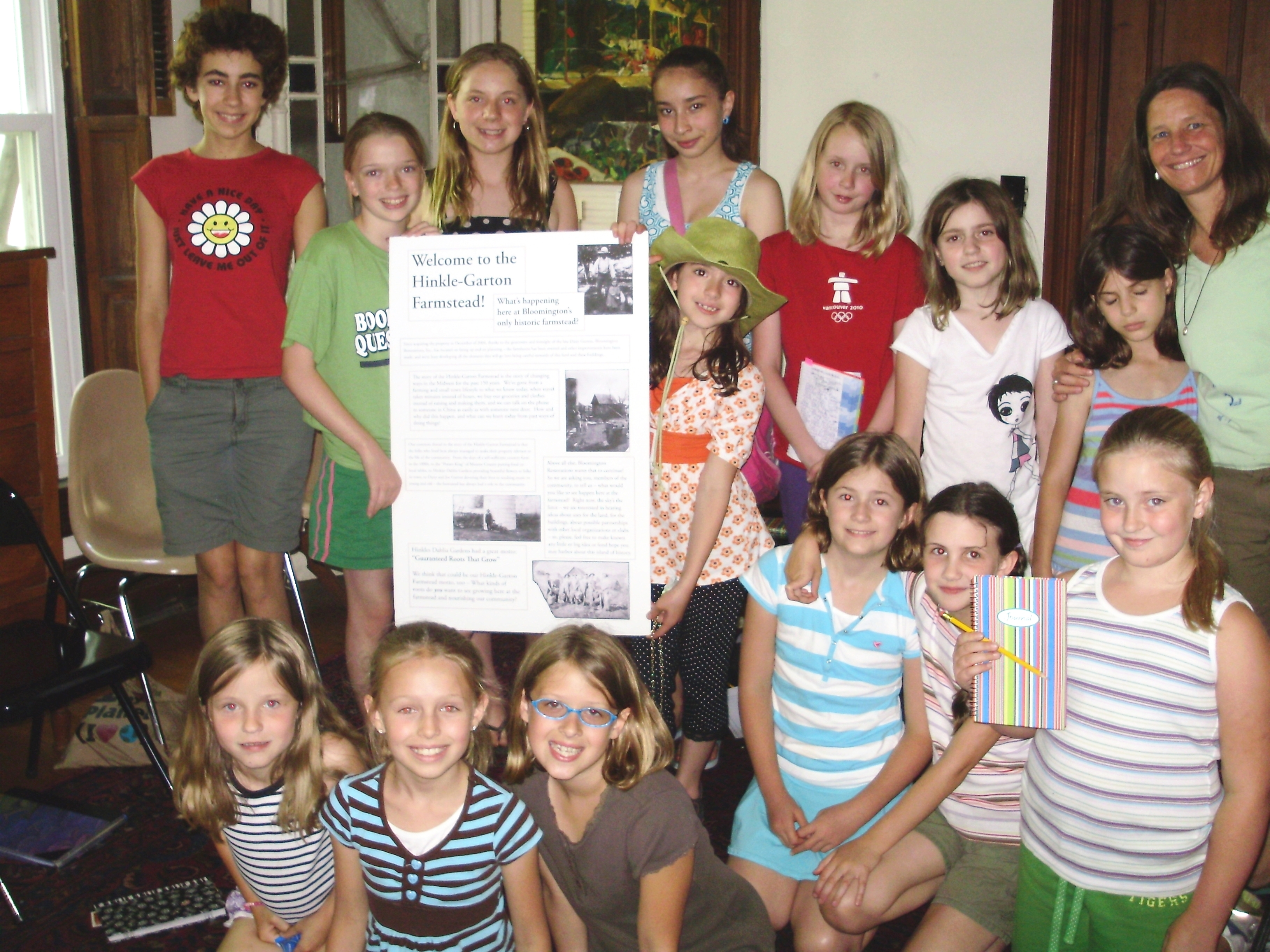 Children present their research and writing project based on the life of the former owners of Bloomington Restorations Inc.'s historic house museum, the Hinkel-Garton Farmstead