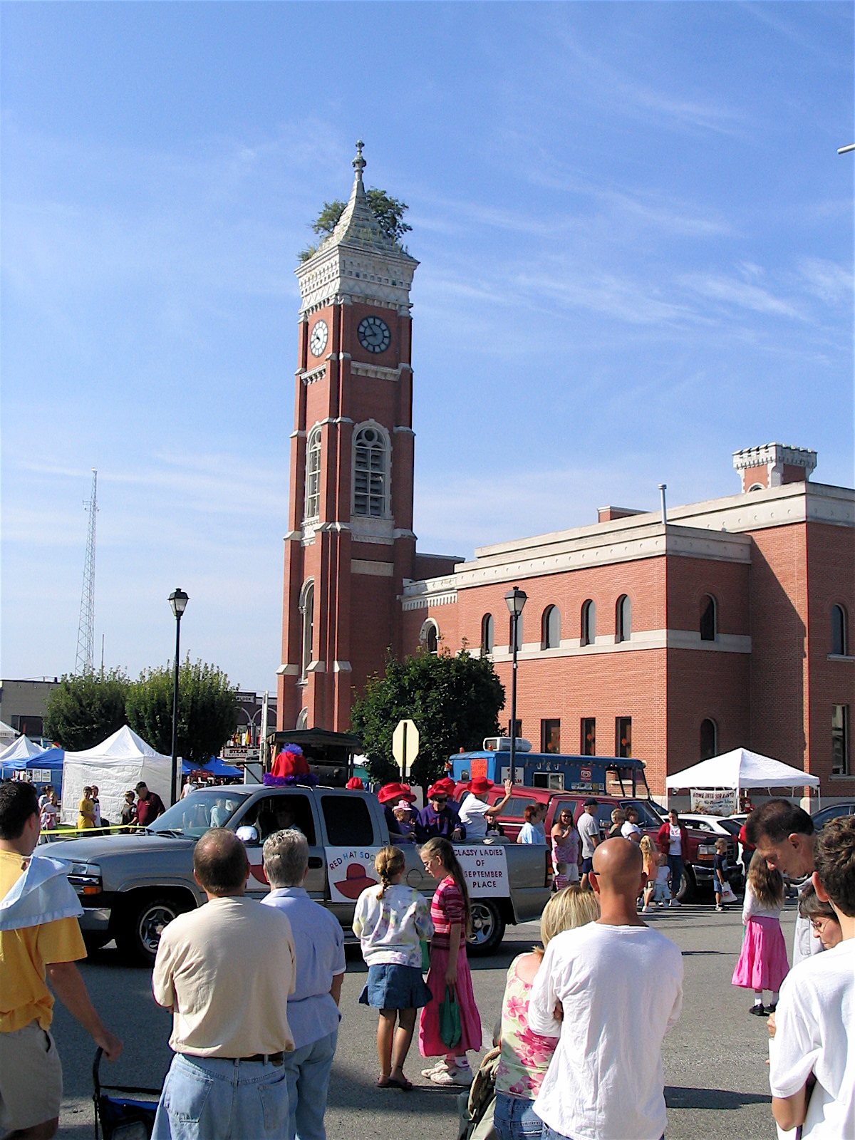 Celebrating the Fall Festival in Greensburg's historic central square, in front of the County Courthouse, famous for the tree growing from its tower