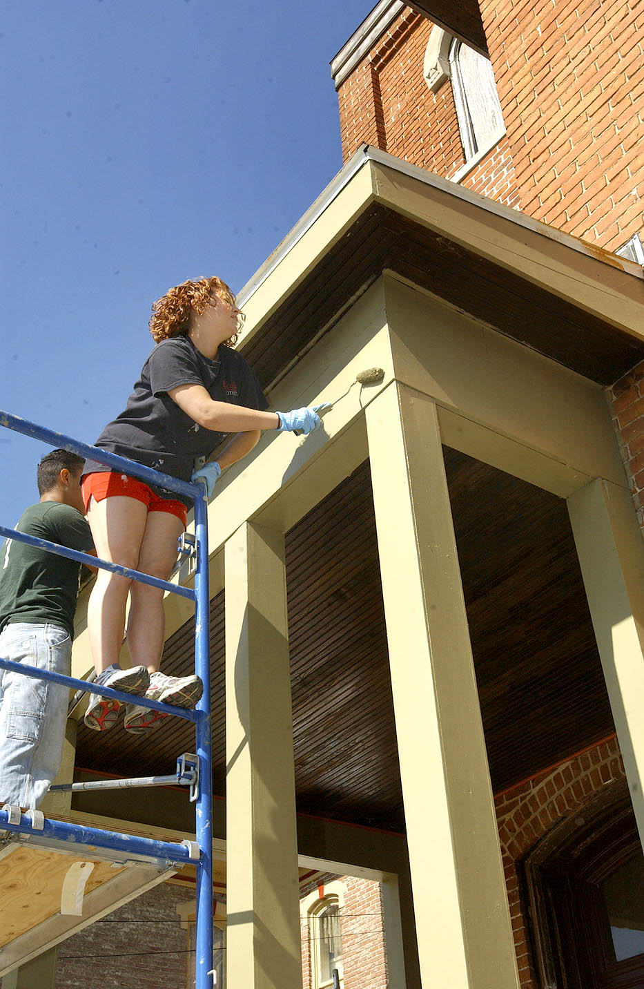 Student helping restore the 1880 Snyder House in the Bankers' Row Historic District, Logansport, Indiana
