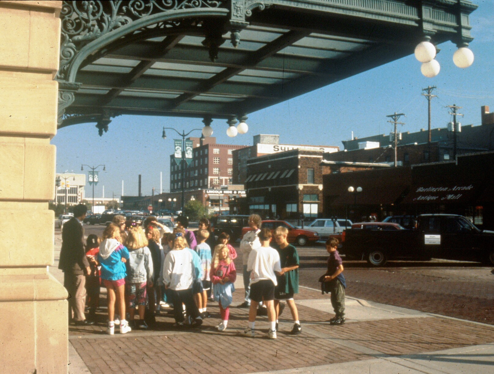 A group of children tour Lincoln, Nebraska's Haymarket Landmark District, which features 19th and early 20th century wholesale houses