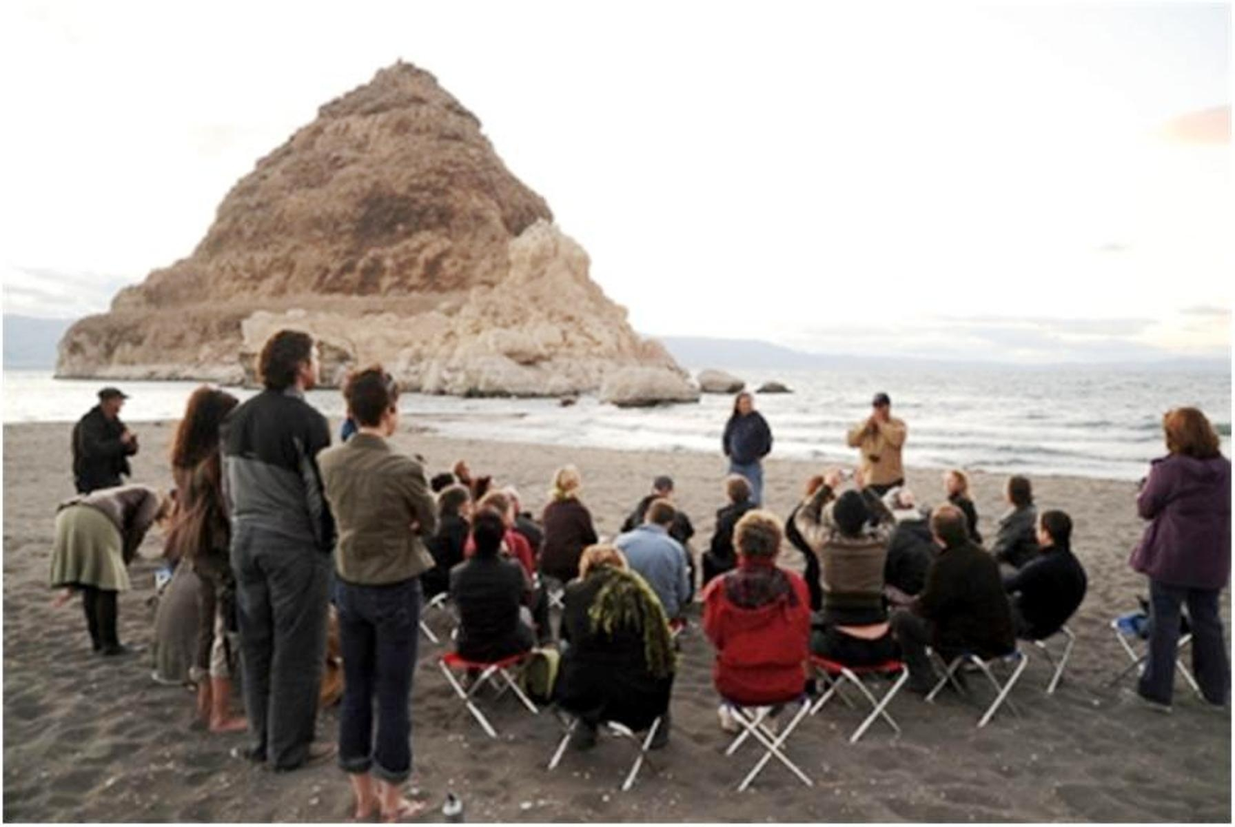 Tribal members telling stories on the shore of Pyramid Lake