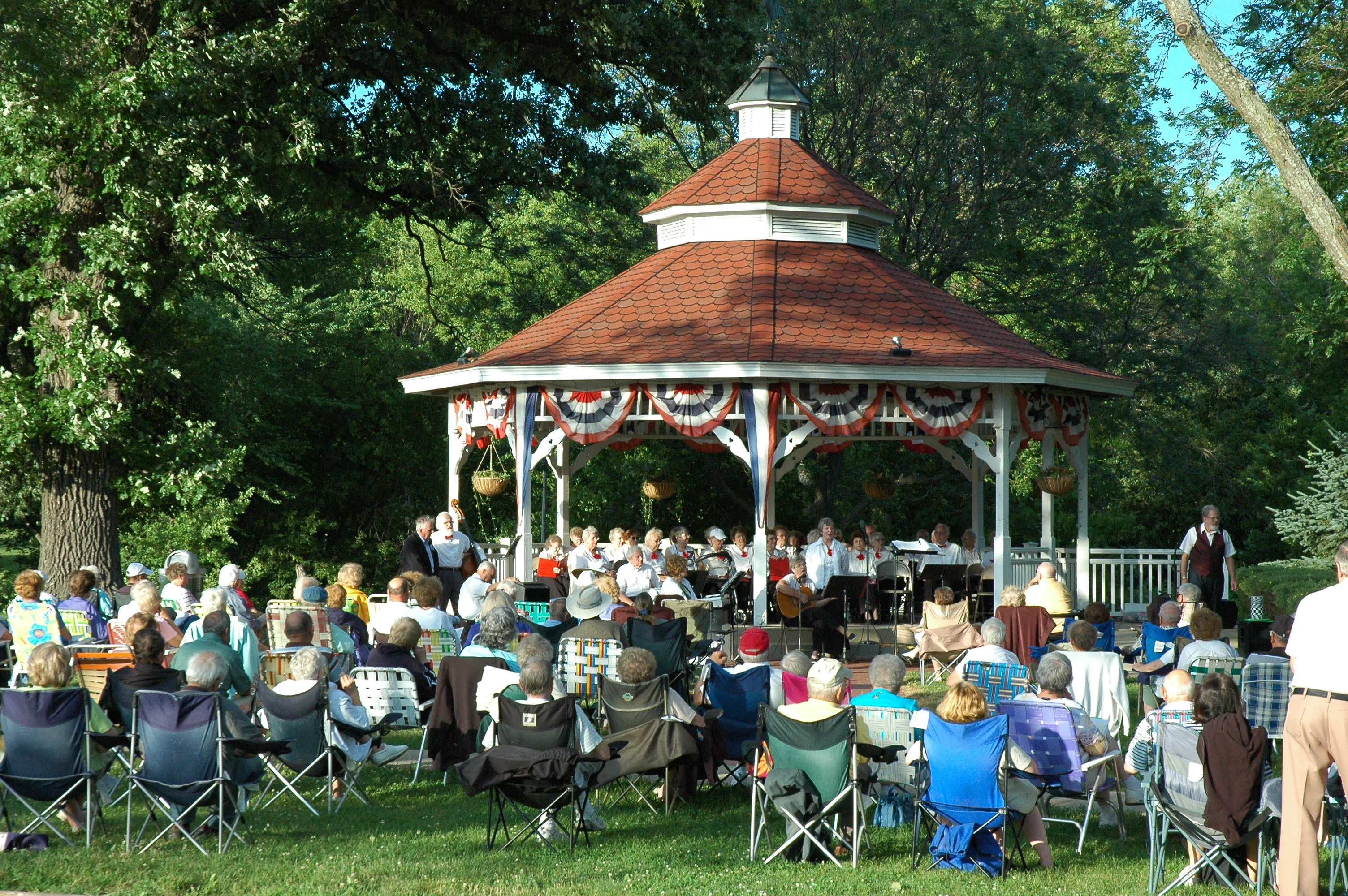 A band concert at the gazebo in central historic Greendale.