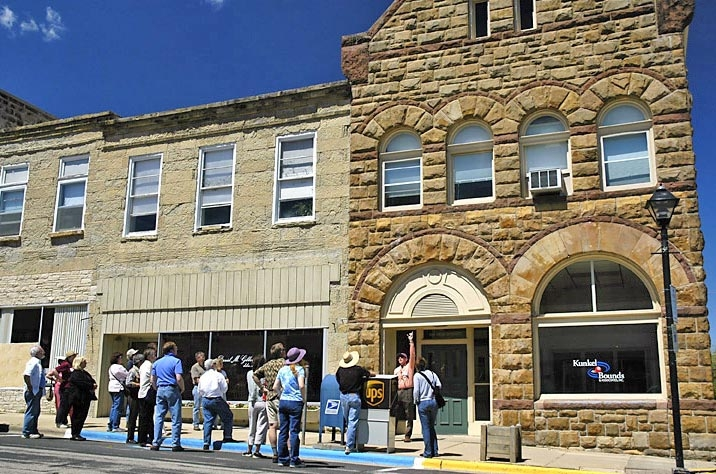A tour group visits historic downtown Mineral Point.