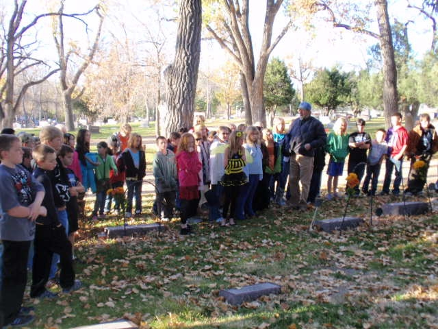 Douglas third graders learning local history during an historic cemetery tour.