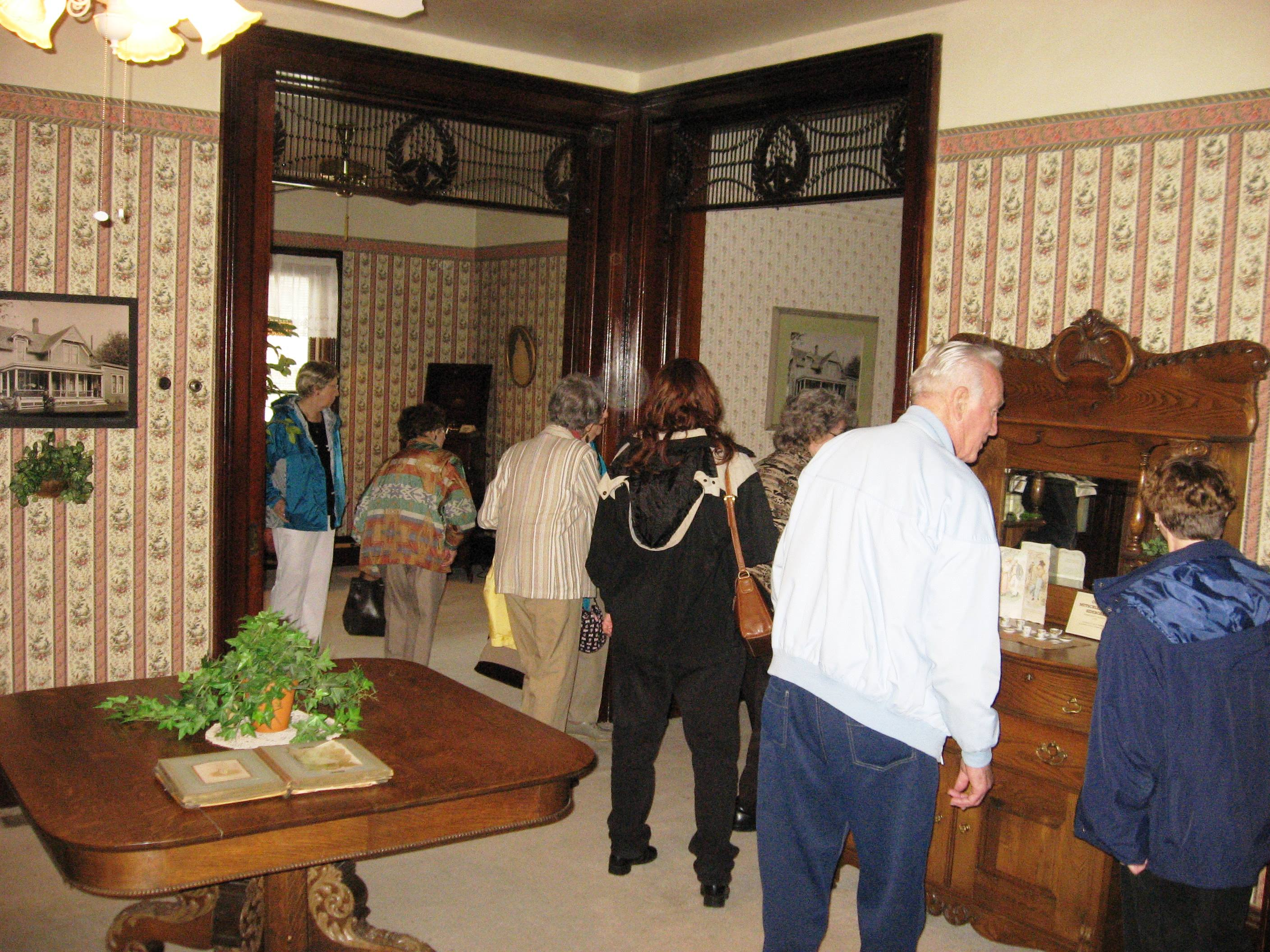 Visitors tour the 1898 John Hartman home, which is attached to the Nappanee Center.