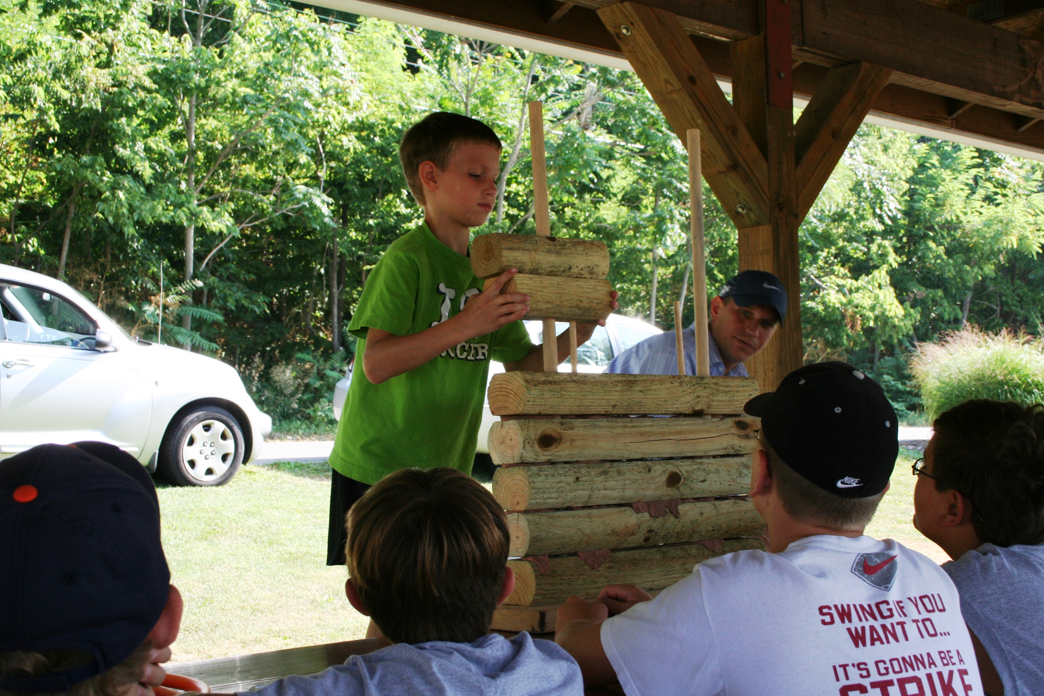 Children taking part in ArchiCamp, sponsored by Historic Landmarks Foundation of Indiana and the Dr. James Ford Historic Home, learn how a log wall was constructed.