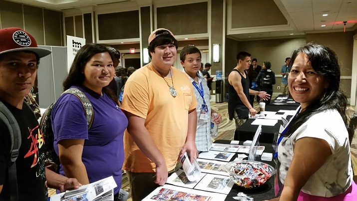 Dr. Dorothy Lippert (right), a member of the Advisory Council on Historic Preservation, talks with Native Youth at the UNITY Career Expo.