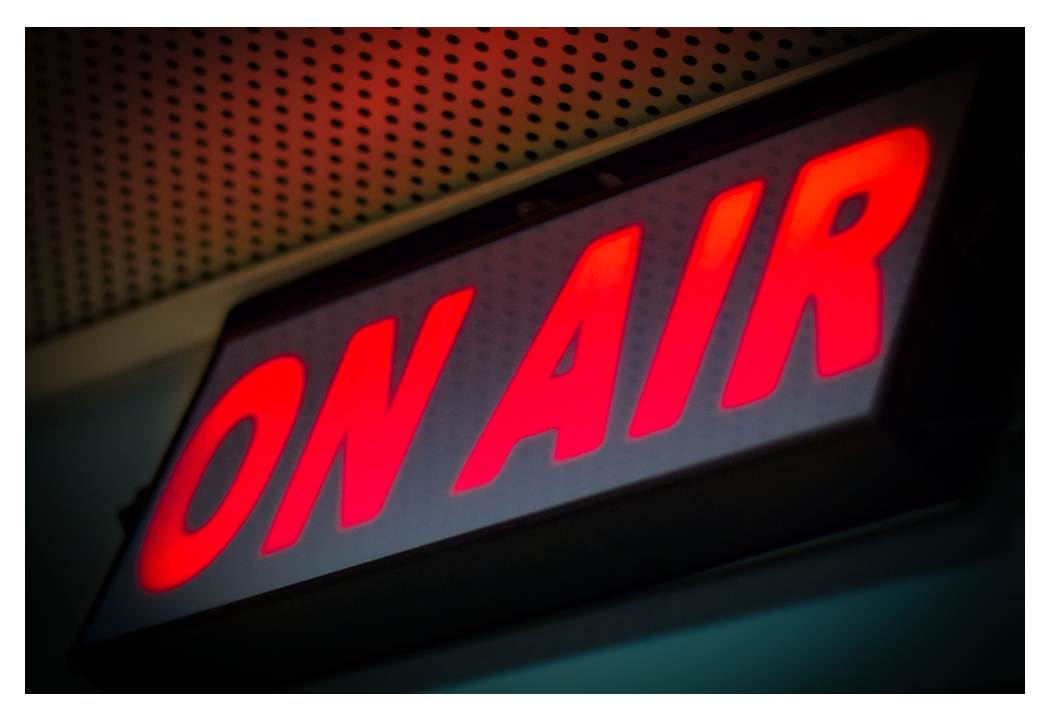 "Glowing ""ON AIR"" sign for live webinars"