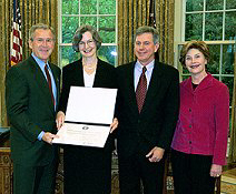 The Bushes with Mary Regan and Wayne Martin. (White House photo by Paul Morse)