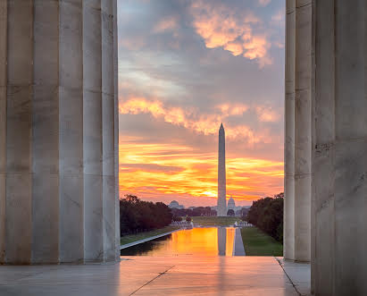 Washington Monument overlooking the National Reflecting Pool at sunset