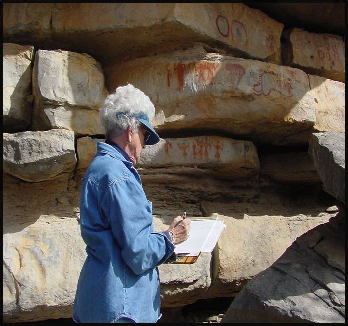 Texas Archeology Steward Teddy Lou Stickney documenting Native American pictographs at the Paint Rock Site in Concho County, Texas.