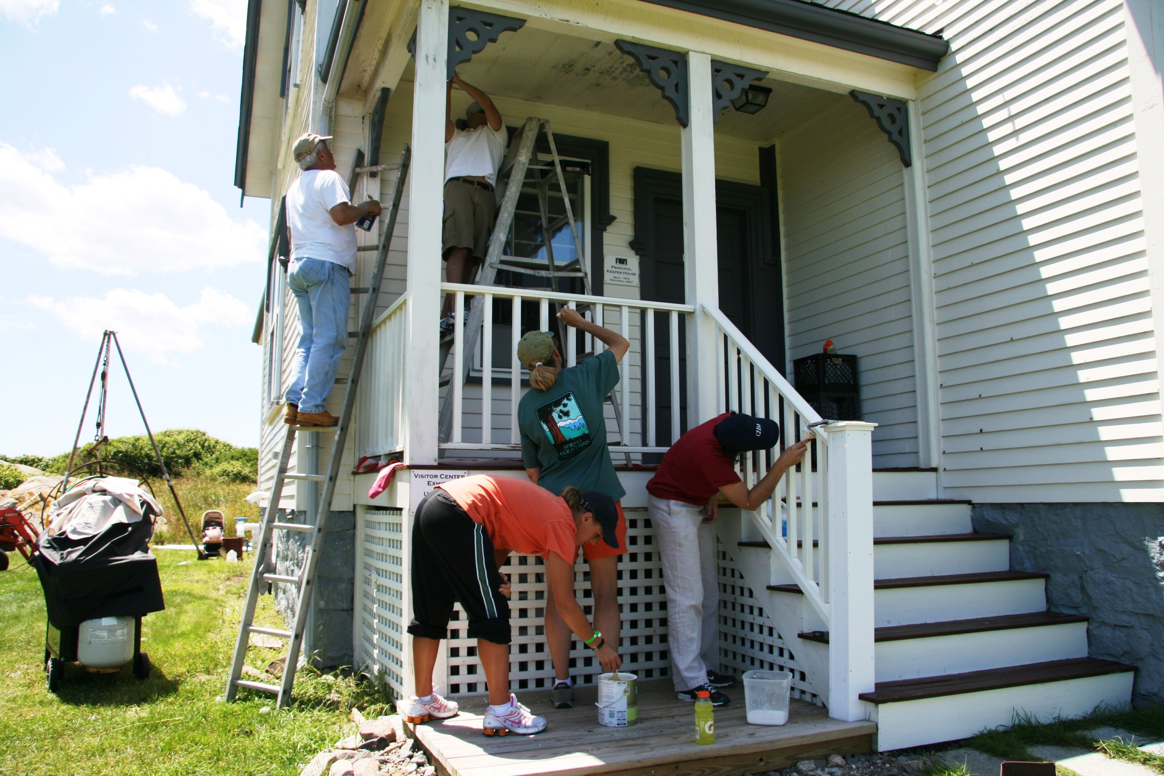 Volunteers painting the Cape Ann Light Station keeper's house.