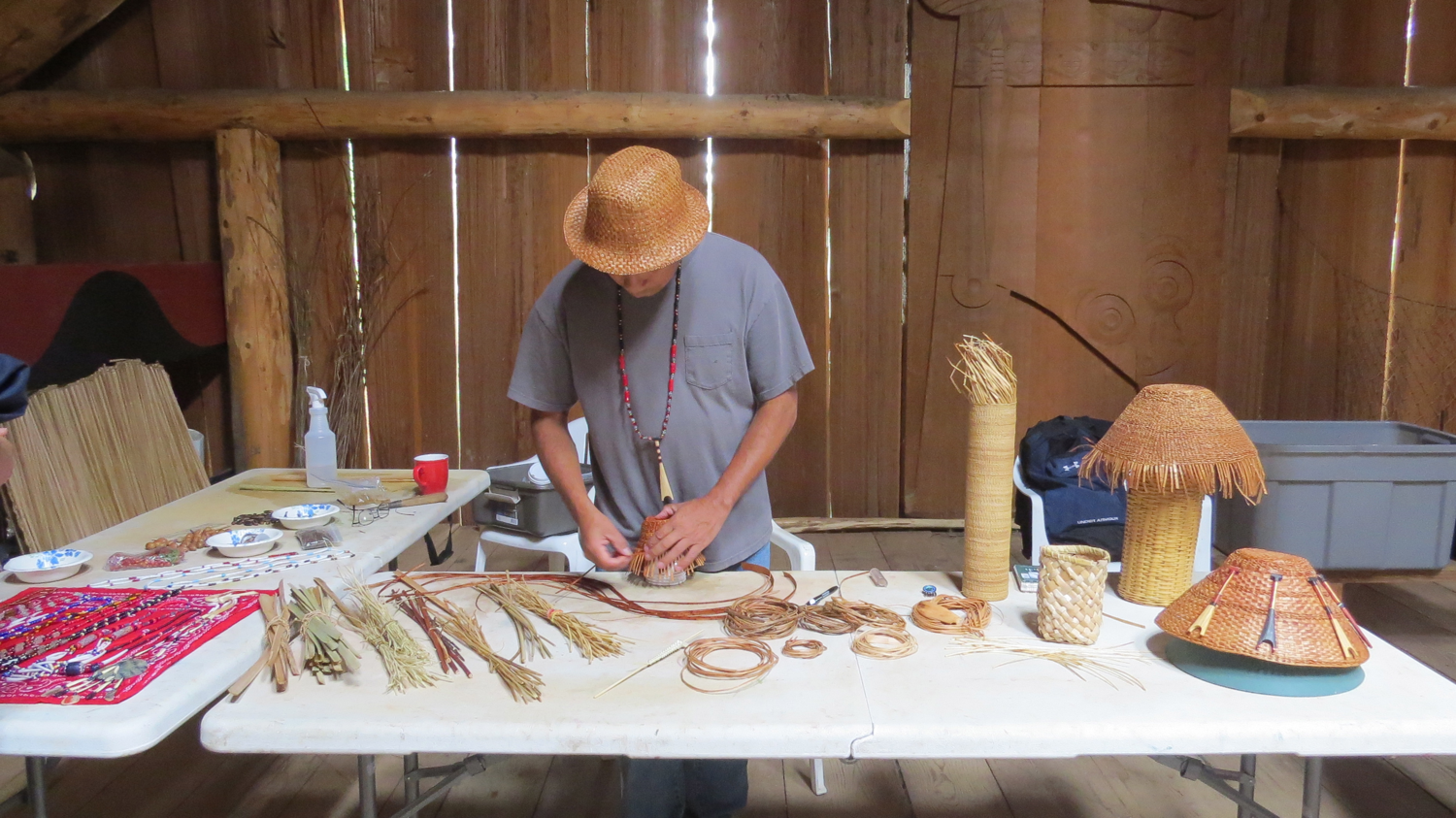 Artist-in-residence Greg Archuleta prepares demonstration materials for visiting students